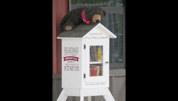 Abearham Lincoln is watching over the Little Free Library at Lincoln School in Anna.
