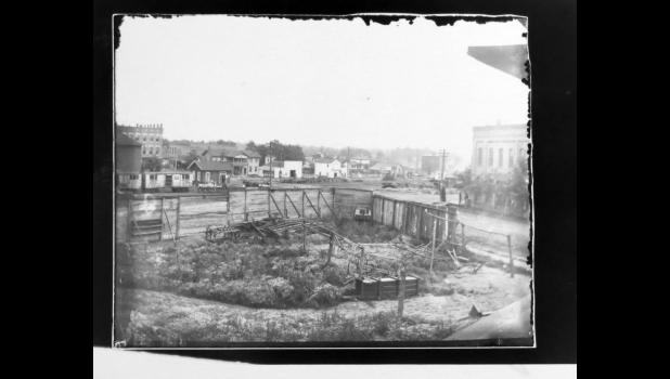 """A bit of an update...a couple of weeks ago, we shared this image with you. The """"old-time"""" photo was discovered recently at The Paragraph Factory. One person shared on Facebook that the photograph was taken at the corner of Davie Street and Main Street in Anna, where the First National Bank originally was built. Another person shared an email which suggested that the photograph probably was taken around 1878 or 1880. Not by me, though. Thanks, folks, for sharing your information...and for reading this..."""