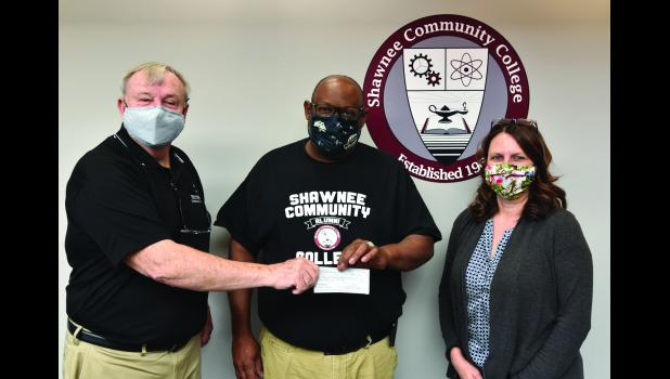 From left are Gene Honn, Saints Foundation executive director; Craig Bradley, Shawnee Community College Phi Theta Kappa Honor Society chapter sponsor; and Tina Dudley, administrative assistant for the Shawnee Community College Saints Foundation. Shawnee Community College photo.