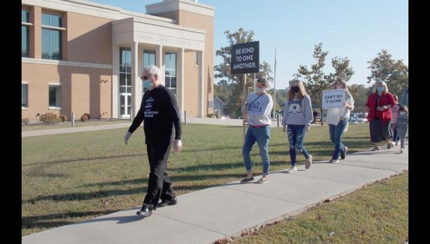 "During October, former Southern Illinois Congressman Glenn Poshard is leading ""silent marches"" throughout the region in a call for a return to peace, unity and civility during a tumultuous time in the nation's history. On Wednesday, Oct. 7, Poshard, left, led a march at the Union County Courthouse in Jonesboro."
