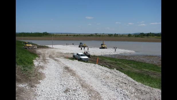 A sand boil near Wolf Lake created concerns in the midst of major flooding which occured along the Mississippi River. Work continued on Saturday to stabilize the sand boil. A liner and rock were laid in the water.