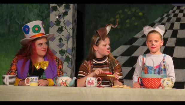 The tea party attendees were the Mad Hatter, played by Jessi Riley, the March Hare, played by Caroline Hansen, and the Dormouse, played by Kenzie Stover.