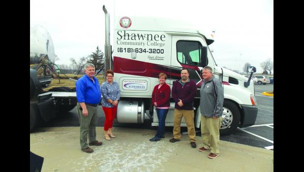 Representatives of Shawnee Community College and Schwerman Trucking gathered for the donation of a Freightliner commercial semi truck and liquid tanker to the SCC truck driving program. Featuring an automatic transmission, the truck will allow for even more students to pursue a career in the trucking industry. From left are Tim Hodges from Schwerman Trucking, SCC dean of academic affairs Dr. Kristen Shelby, SCC interim president Dr. Kathleen Curphy, SCC truck driving coordinator Kelly Jennings and SCC advis