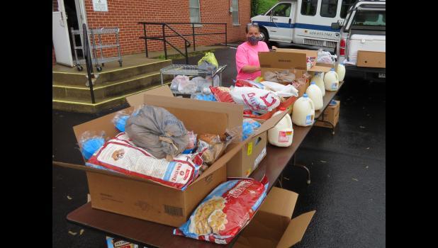 Shawnee Development Council Union County coordinator Brandy Sevenski was preparing to distribute food Wednesday morning, April 29, in Jonesboro.
