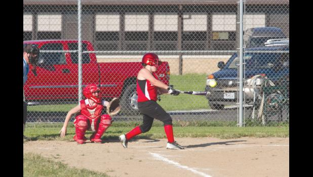 Shawnee Junior High School softball team faced Meridian Junior High on Tuesday, Aug. 30. Shawnee's Autumn Derossett posted a hit during the game. Photo by Tiffiny Dillow for The Gazette-Democrat.