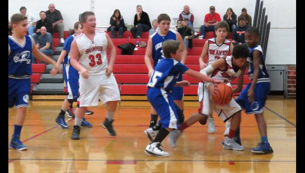 Shawnee Junior High School, in white uniforms, hosted Lick Creek in boys' basketball action Tuesday, Jan. 17. Varsity and junior varsity games were played. Photo by Amber Skelton.