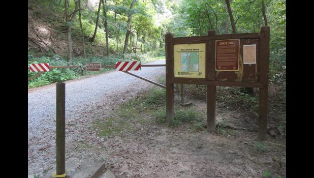 The Snake Road at the LaRue Pines Hills Research Natural Area near Wolf Lake: at the time that the photograph was taken, the road was closed for the fall season migration of snakes and other creatures. File photo.