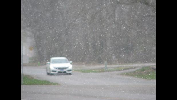Snow...SNOW...on the 8th day of April! Normally, your writer does not like to use exclamation marks, but this time it just seemed appropriate.