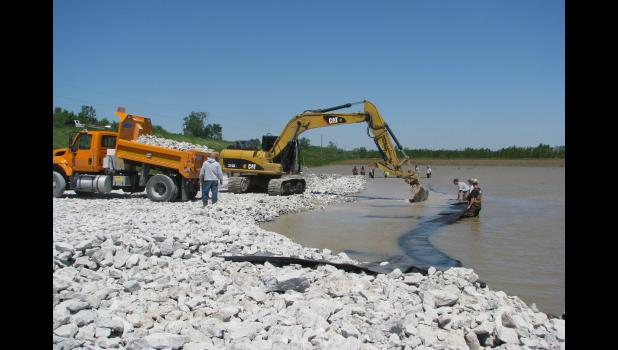 Work was being done Saturday, May 6, to stabilize a sand boil situation along the Mississippi River levee near Wolf Lake.