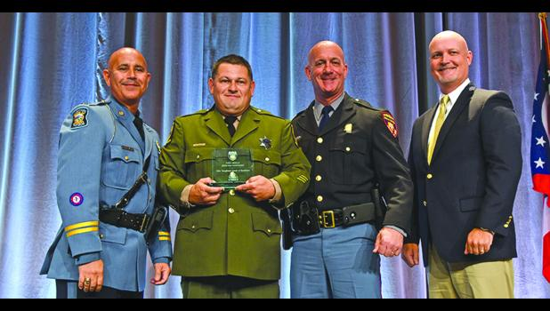 From left are Capt. Chris Turner of the Kansas Highway Patrol, Illinois State Police Trooper Matthew Johnson, Capt. Scott Carnegie of the Mississippi Department of Public Safety and Collin Mooney, executive director of CVSA. Photo provided.