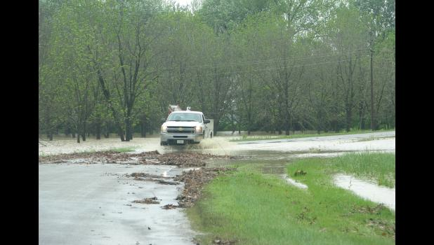 A truck made its way through water and debris which covered part of the State Forest Road in Union County last Saturday morning.