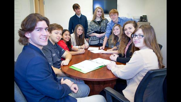 Team 18 at Coad Chevrolet: Sitting, from left, are Bryce Osman, Alex Rogers, Alejandra Lopez, Grace Schroeder, Zoe Fuhrhop, Megan Rhine, Cheyenne Thorn; standing are John Russell, Grace Pitts and Connor Allen. Photo provided.