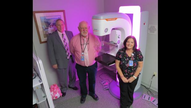 Union County Hospital in Anna hosted an open house on Wednesday afternoon, Oct. 23, which gave visitors an opportunity to see new 3D mammography technology equipment. Those welcoming visitors during the open house included, from left, Jim Farris, Union County Hospital CEO; Peter Wories, the director of radiology at Union County Hospital; and Melinda Young, chief mammography technologist at the hospital.