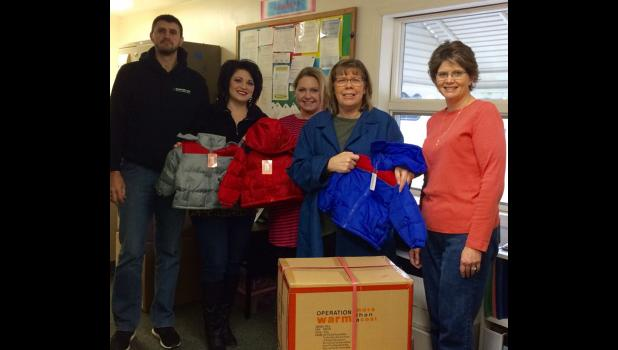 With the help of Shawnee Mass Transit District, SMTD, in Vienna, coats were delivered for Vienna and Goreville Head Starts. From left are SMTD IT specialist Mike Pietrowski, SMTD operations manager Tiffany Ray, Head Start assistant site supervisor and parent coordinator Mandy Wolfe, Head Start coordinator Cheryl Gage and WIBH sales manager Shawnna Rhine. Photo provided.