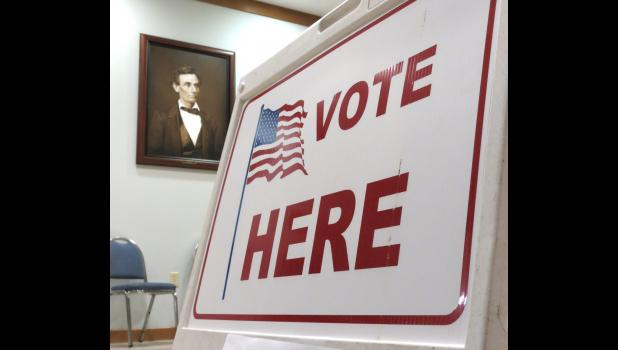 "A portrait of Abraham Lincoln is on display at the Union County Courthouse in Jonesboro, where a ""Vote Here"" sign was seen on the night of Election Day, Tuesday, Nov. 3."