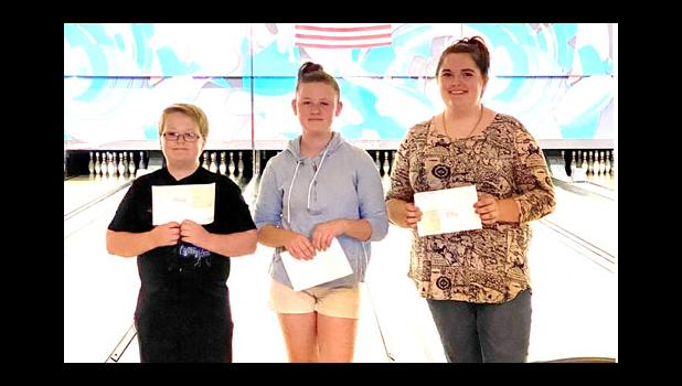 Youth bowlers Logan Quick, Madison Moore and Madi Hawk qualified for state tournament competition. Photo provided.