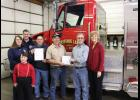 Brian Cox is in the first row. In the second row are Amelia and Tony Smith, Horseshoe Lake Fire Department assistant chiefs; Mike Honey, Horseshoe Lake Fire Department chief; Leslie Bigham, Horseshoe Lake Fire Department president; and Scott and Cheryl Miller, Scott Miller Farms. Photo provided.