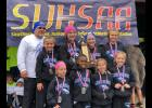 Members of the state champion Lick Creek School girls' cross country team are, in the first row, from left, Mya Clutts, Jadyn Gerardi, Kylee Myers and Natilyn Corbit. In the second row are coach Matt Denny, Kenzie Stover, Kaylee Stover, Brodie Denny and Meranda Wright. Photo provided.