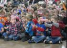 Students at Lincoln Elementary School in Anna displayed American flags during a ceremony Friday morning to honor veterans.