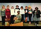 """Those from the Shawnee Community College cosmetology program who participated in a """"living"""" museum presentation included cosmetology instructor Wendy Harris, Melanie Mattheis as Laura Ingalls Wilder, Jennifer Capron as Alice Pole, Kelly Messmore as Lucy Stone, Alazeye Bellamy as Lucy Bridges, Madison Hartline as Mary Kay Ash, Alaina Pinnon as Dolly Parton, Breanna Childs as Madam C.J. Walker and, in front, Uniqua Vaughn as Rosa Parks. Shawnee Community College photo."""
